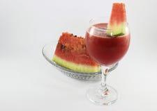 Succo dell'anguria ed anguria affettata Immagine Stock
