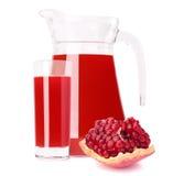 Succo di frutta del melograno in lanciatore di vetro Fotografia Stock Libera da Diritti