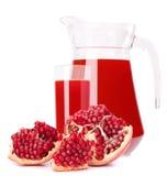 Succo di frutta del melograno in lanciatore di vetro Fotografie Stock Libere da Diritti
