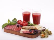 Succo di pomodoro con il sandwich Immagini Stock