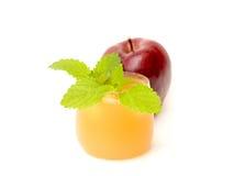 Succo e mele di mele Immagini Stock