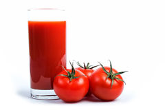 Succo e pomodori di pomodoro fotografia stock libera da diritti