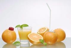 Succo ed aranci di arancia Immagine Stock