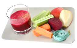 Succo ed ingredienti freschi per una dieta sana sopra Fotografia Stock Libera da Diritti