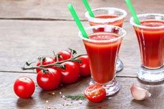 Succo, pomodori e spezie di pomodoro Fotografie Stock