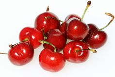 Succulent cherries. A group of ripe succulent red cherries, with their stalks attached stock photography