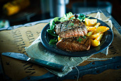 Succulent grilled beef steak and vegetables stock photos