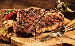 Succulent grilled t bone steak with fork and knife royalty free stock image