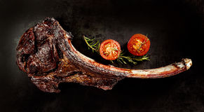 Succulent grilled tomahawk beef steak Stock Images