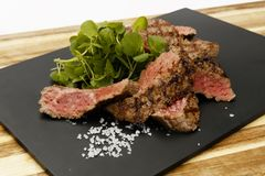 Succulent and juicy rare beef steak, with watercress garnish stock images
