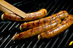 Succulent juicy sausages grilling on a BBQ stock photos