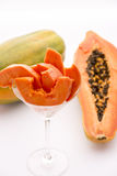 A succulent juicy snack - the Pawpaw fruit. A long-stemmed cocktail glass filled with tangerine papaya slices. The papaya is also called papaw or pawpaw Stock Image