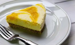 Succulent Lemon Cheese Cake on white plate wiith folk stock photo