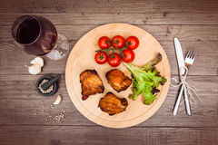 Succulent pieces of grilled pork fillet served with cherry tomatoes. royalty free stock images