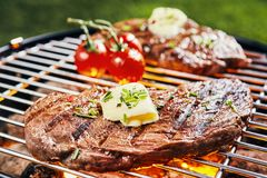 Free Succulent Portion Of Rump Steak Grilling On BBQ Royalty Free Stock Photography - 145825417