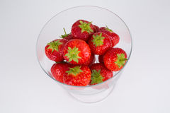 Succulent ripe strawberries in a glass dish Stock Images
