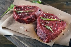 Succulent tender raw lean beef steaks lying Stock Image