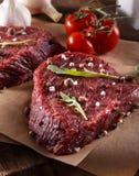 Succulent tender raw lean beef steaks Stock Photos