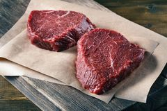 Succulent tender raw lean beef steaks lying Royalty Free Stock Photos