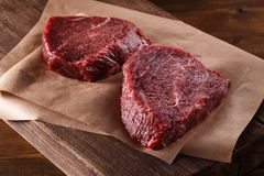 Succulent tender raw lean beef steaks lying Stock Images