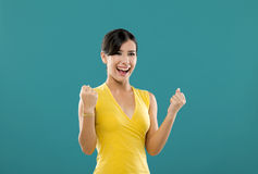 Sucess. Beautiful  and happy asian woman, over a blue background Royalty Free Stock Images