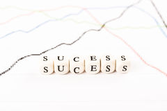 SUCESS word written with wooden cubes Stock Photos
