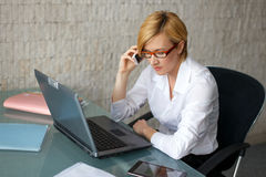 Sucessful blonde businesswoman working hard Stock Images