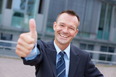 Sucessful business manager holding Royalty Free Stock Images