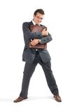 Sucessful businessman. Handsome businessman hugging his briefcase stock image