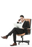 The sucessful businessman multitasking Stock Photo