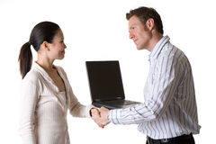 Sucessful deal. Caucasian man shaking hands with Asian woman after a successful business deal Stock Images