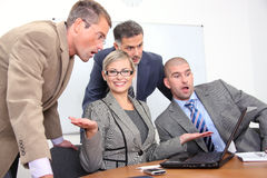Sucessful teamwork. Business women and men working in office Stock Photo