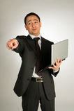 Sucessfull businessman with laptop pointing Stock Photos