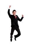 Sucesso da celebração do homem de negócios, salto do homem de negócios isolado sobre imagem de stock