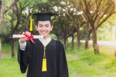 Sucesso da concessão do graduado da graduação Foto de Stock