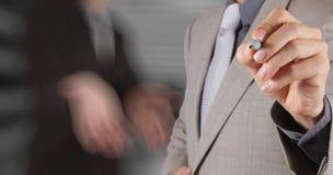 Sucesso do homem de negócios com sua sala de direção Fotos de Stock