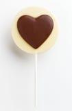Sucette en forme de coeur de chocolat d'amour Images stock