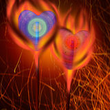 Sucettes colorées parmi le feu Image stock