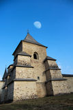 Sucevita monastery. Tower of Sucevita Monastery with beautiful moon on the blue sky Royalty Free Stock Photo