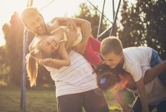 Such moments are remembered. Family on playground stock images