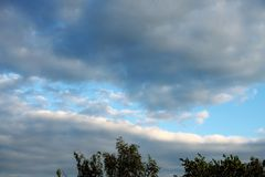 Such a rarity,a blue streak of sky between rain clouds. royalty free stock images