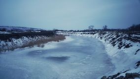 Such a severe frost that the river froze to the very bottom. March frost is very strong. Stock Photo