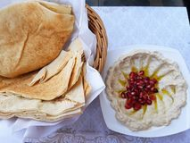 Humus with a Twist! Hot Arabian bread. Such a simple puree of Chick peas is brought to life with the addition of some Pomegranate Seeds Stock Image