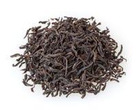Sucha czarna herbata odizolowywająca na bielu Zdjęcia Royalty Free