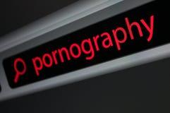 Suchen des Pornos lizenzfreies stockfoto