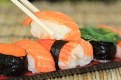 Suchi with chopsticks Stock Image