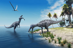 Suchomimus Dinosaurs. A large fish is caught by a Suchomimus dinosaur while a flying Pterosaur dinosaur watches for scraps to eat Royalty Free Stock Photo