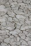 Suciedad seca y agrietada del desierto Foto de archivo libre de regalías
