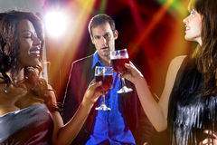 Suckered by Girls at a Nightclub Royalty Free Stock Image