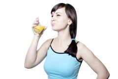 Suco bebendo da rapariga Foto de Stock